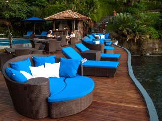 Pool side deck and loungers.